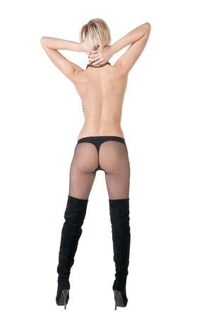 nude blond: Rear view of nude blond woman in stockings .