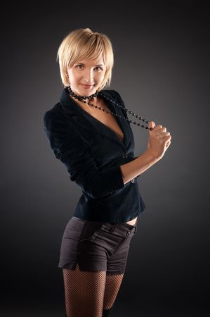 sexual blond woman in short skirt . Black background. photo
