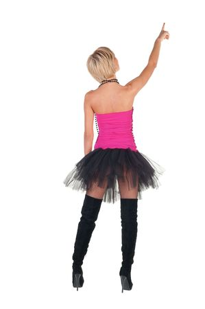 Extravagant blonde in  crown pointing. Rear view . photo