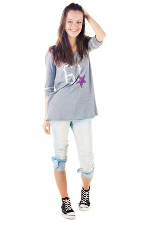 Young smiling brunette in jeans. Isolated over white . Stock Photo - 6744576