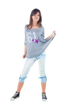 Young smiling brunette in jeans. Isolated over white . Stock Photo - 6744561