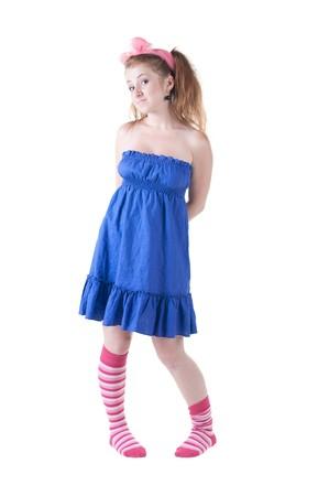 lovely red-haired girl in  dark blue sundress. Isolated over white . photo