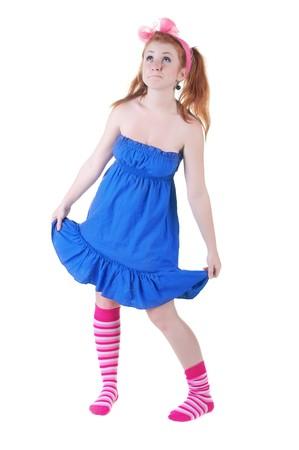 lovely red-haired girl in  dark blue sundress. Isolated over white . Stock Photo - 7270162