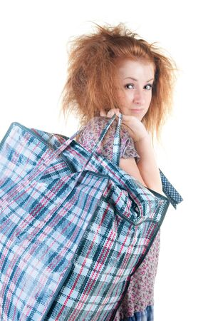 shoppingbag: Tired woman with shopping bag. Isolated over white . Stock Photo