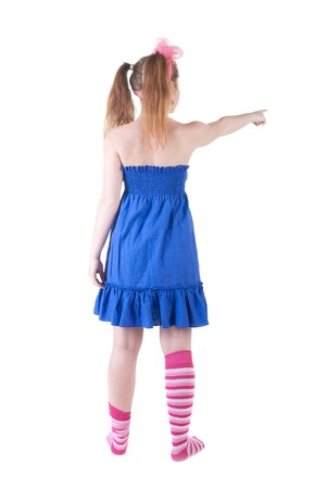 Young teenager girl points at wall. The rear view . photo