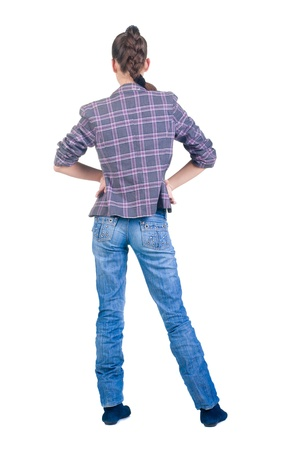 Beautiful young brunette in  checkered jacket looks in  distance. Rear view.Isolated over white. photo