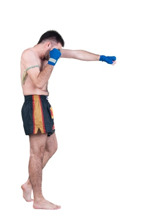 thai boxing:  Muay Thai  fighter . Isolated over white background. Stock Photo