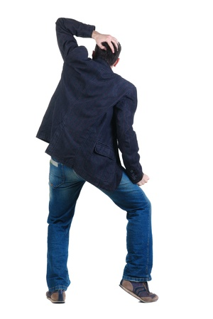 angry young man. Rear view. isolated over white. photo