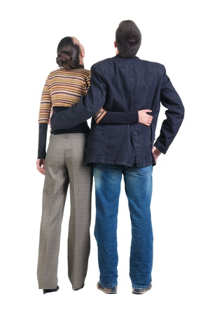 Young couple looks where that. Rear view. Isolated over white. Stock Photo - 8434323