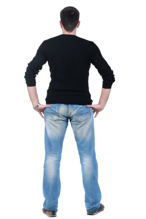 looking behind: young man looks ahead. rear view. Isolated over white .