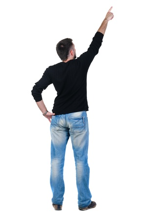 backside: young man pointing at wall. rear view. Isolated over white .