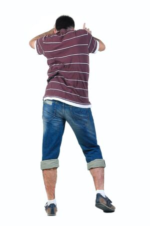 Young man dancing. Rear view. Isolated over white. photo