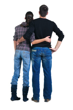 woman from behind: Young couple looks where that. Rear view. Isolated over white. Stock Photo