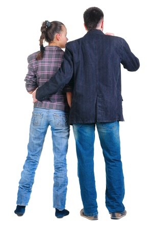 looking behind: Young couple looks where that. Rear view. Isolated over white. Stock Photo