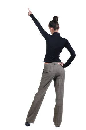 Beautiful young woman pointing at wall. Rear view. Isolated over white backrgound. Stock Photo - 8599111