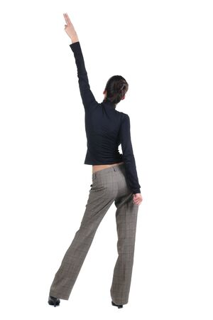 Beautiful young woman pointing at wall. Rear view. Isolated over white backrgound. Stock Photo - 8599104