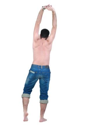 seminude: seminude giovane uomo guarda avanti. Vista posteriore. Isolato su bianco.