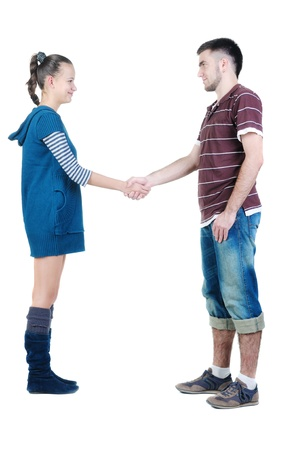 Young couple hand shake. Isolated  over white. Stock Photo - 8665525