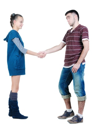 Young couple hand shake. Isolated  over white. Stock Photo - 8665526