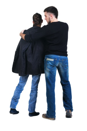 Young couple looks where that. Rear view. Isolated over white. Stock Photo - 8665529