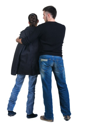Young couple looks where that. Rear view. Isolated over white. Stock Photo - 8665528