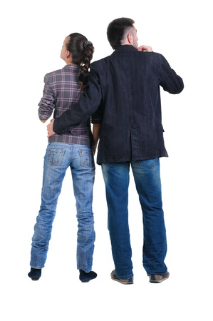 Young couple looks where that. Rear view. Isolated over white. Stock Photo - 8665530