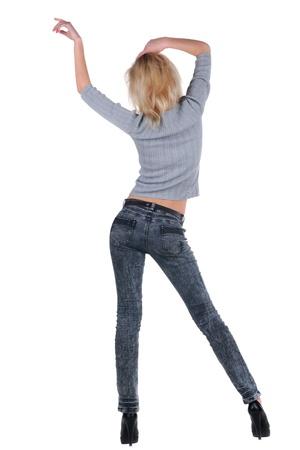 donna che balla: Giovane donna ballando. Vista posteriore.