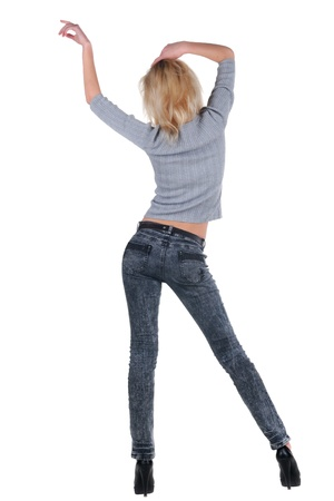 dancing pose: Young woman dancing. Rear view.  Stock Photo