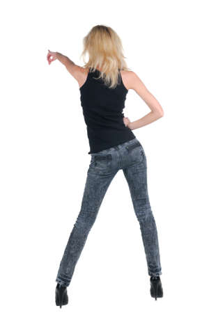 Beautiful young woman pointing at wall. Rear view. Isolated over white. Stock Photo - 9258337