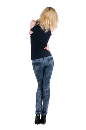 Beautiful young woman looking at wall. Isolated over white. Rear view. Stock Photo - 9258344