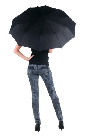 Blond young woman under an umbrella. Isolated over white. Rear view. photo