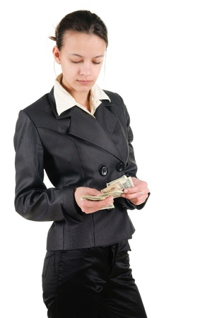 Young businesswoman counts money. Isolated over white. photo