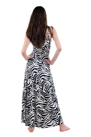 Beautiful young woman looking at wall. Rear view. Isolated over white. photo