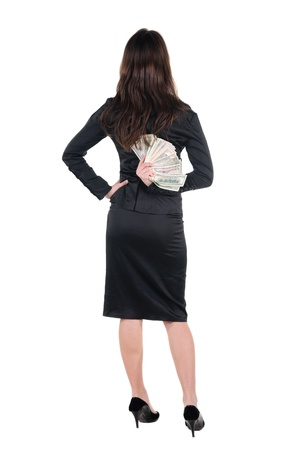Beautiful young woman with money. Rear view. photo