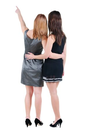 Two young women rear view. Isolated over white. Stock Photo - 10002474