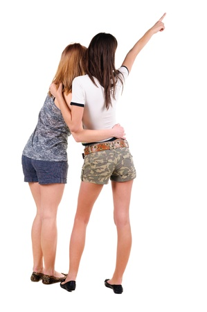 Two young women rear view. Isolated over white. Stock Photo - 10002483