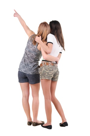 Two young women rear view. Isolated over white. Stock Photo - 10002482
