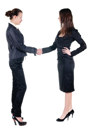 Two businesswoman handshake . Isolated over white . photo