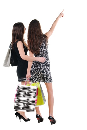 Three woman with shopping bag. rear view. Isolated over white. photo