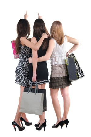 friends shopping: Three woman with shopping bag. rear view. Isolated over white.