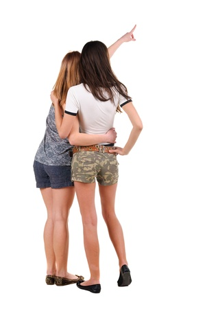 Two young women rear view. Isolated over white. Stock Photo - 10002292