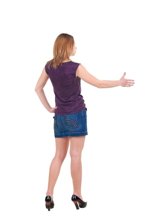 Beautiful young woman handshake . Rear view. Isolated over white. photo