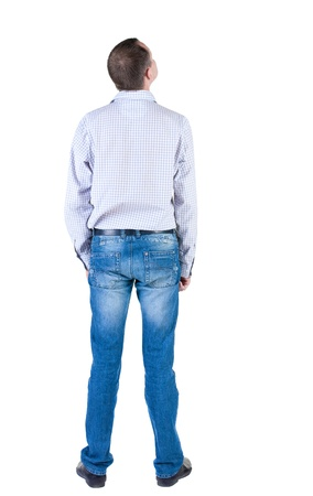 young expert looks ahead. rear view. Isolated over white . Stock Photo - 10864716
