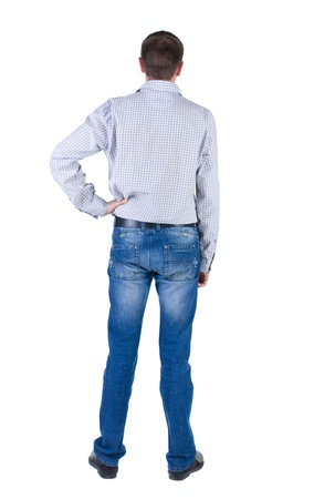 young expert looks ahead. rear view. Isolated over white . Stock Photo - 10864675
