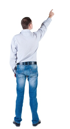 1 person only: young man pointing at wall. rear view. Isolated over white .