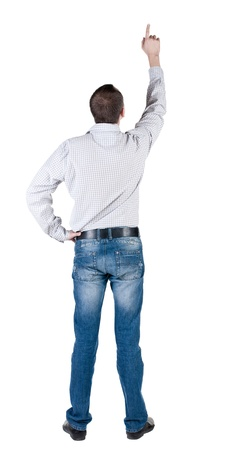 young man pointing at wall. rear view. Isolated over white . Stock Photo - 10864700