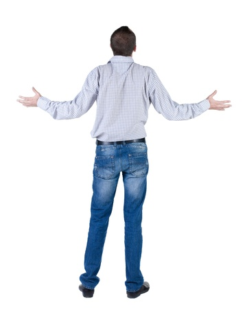 back posing: angry young man. Rear view. isolated over white.