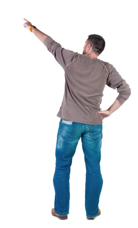 young man pointing at wall. rear view. Isolated over white . Stock Photo - 10864731