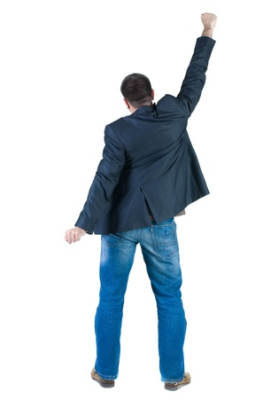victorious: Businessman thumbs up. rear view. Isolated over white . Stock Photo