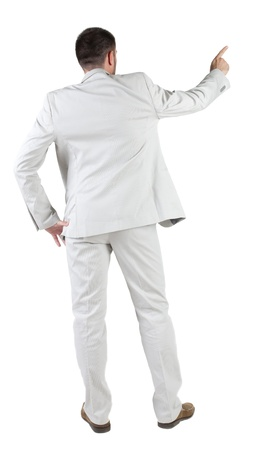 point of sale: Businessman pointing at wall. rear view. Isolated over white .  Stock Photo